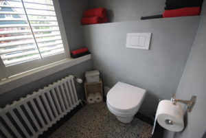 Betonlook muur voor badkamers en keukens helming tegelwerken